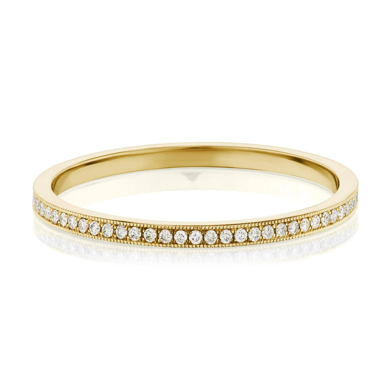 Pave diamond wedding ring in yellow gold