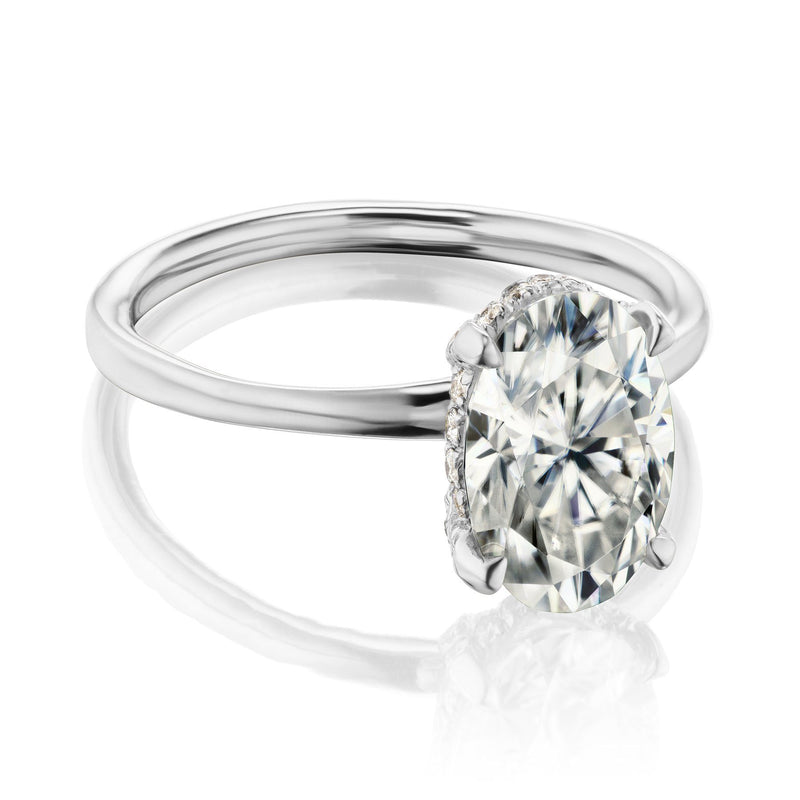 Oval hidden halo engagement ring in white gold