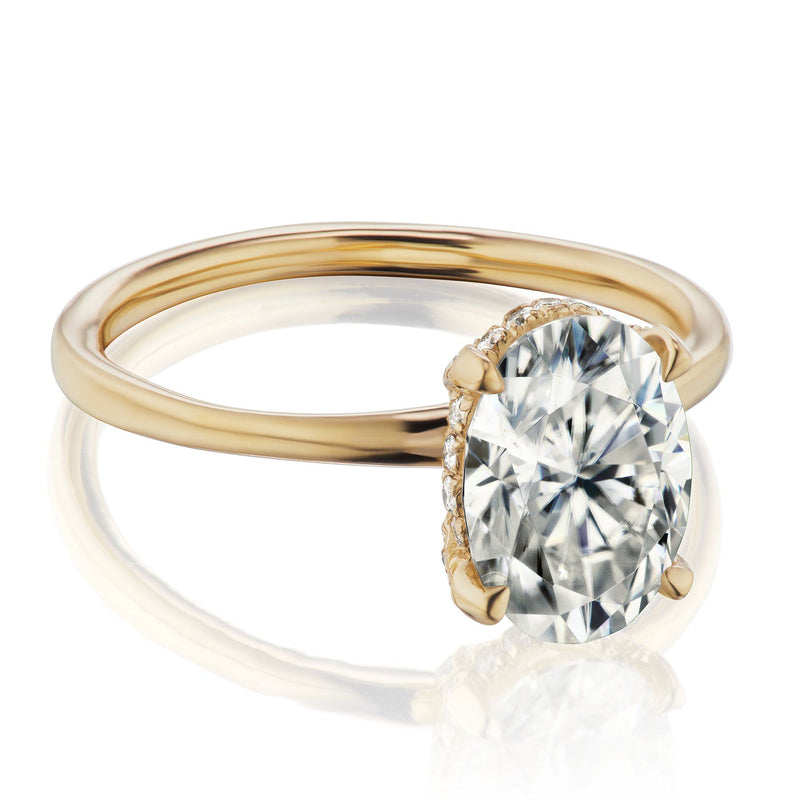 Oval diamond hidden halo engagement ring