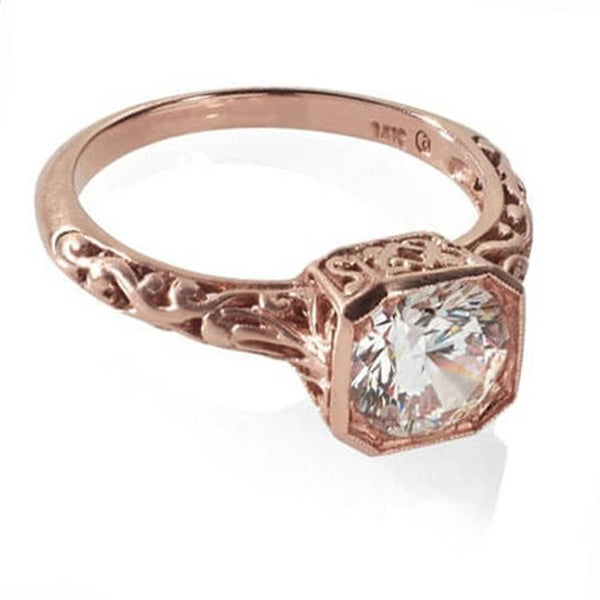 Rose gold antique engagement ring with filigree detail