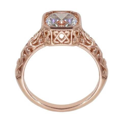 Rose gold antique engagement ring with detail on sides