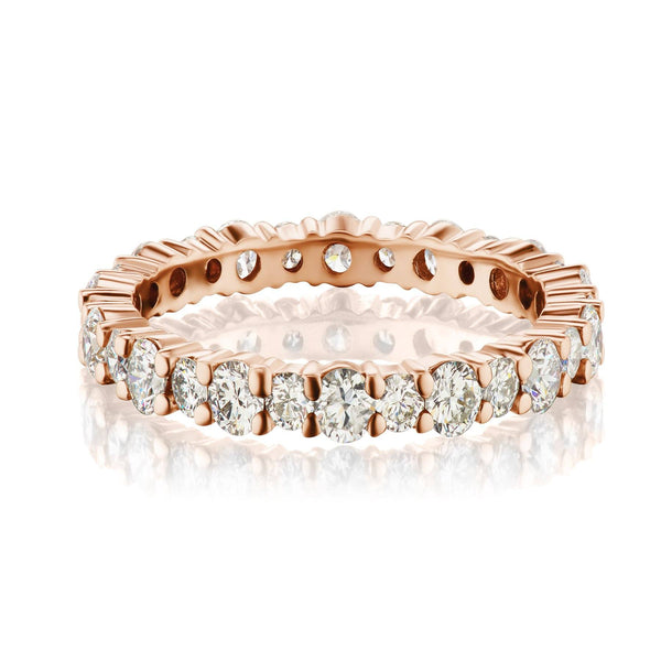 Shared prong diamond band in rose gold