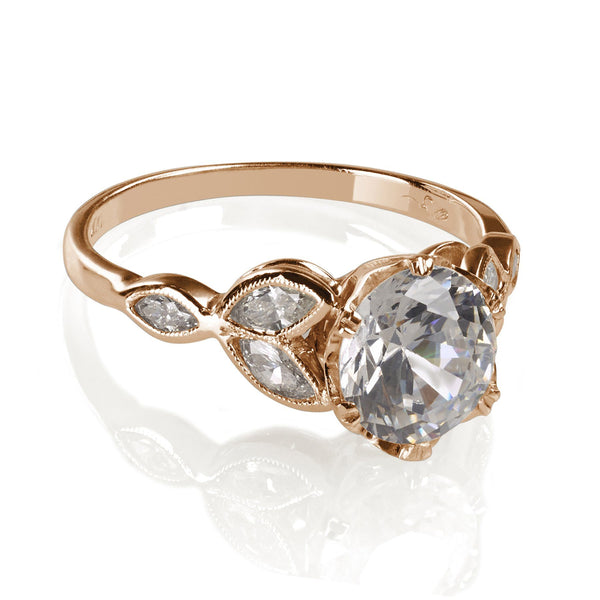 Rose Gold engagement ring with marquise diamonds