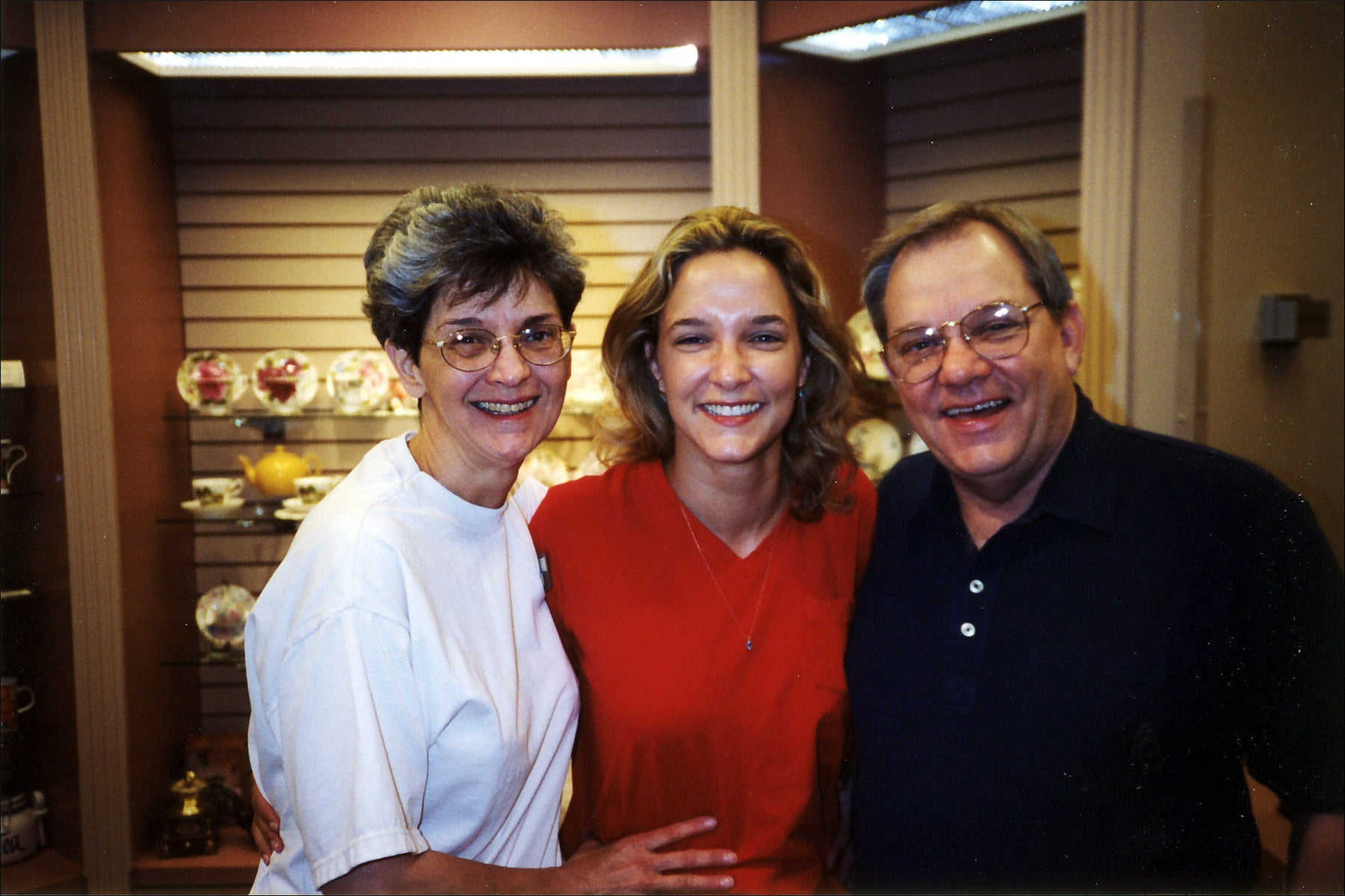 The Clark family, at the Coffee Classics store, 1998: Sharon, Carrie, and John.