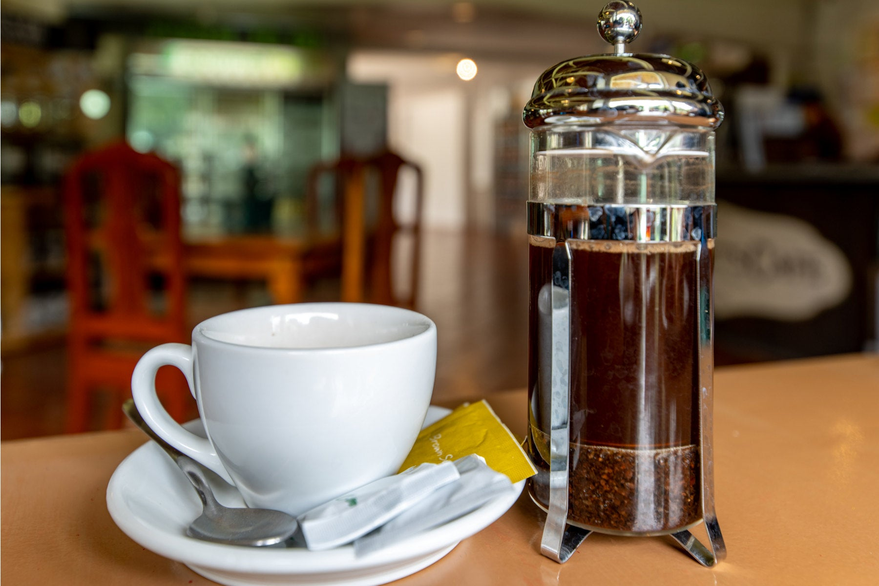 Photo of French Press brewer and coffee cup