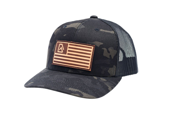 Nuvo structured, mid profile, snapback, trucker hat with leather American flag and Nuvo logo patch (side view)