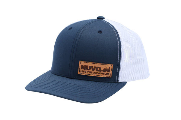 Nuvo structured, mid profile, snapback, trucker hat with leather Live the Adventure and pine trees patch (side view)