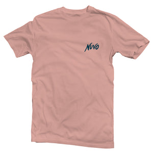 The front of a desert pink, Nuvo brand, short sleeve graphic t-shirt featuring Nuvo logo on left chest