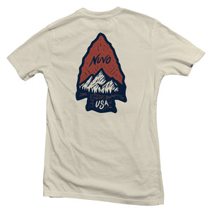 The back of a cream-colored, Nuvo brand, short sleeve graphic t-shirt featuring mountain and lake scene inside of arrowhead shape
