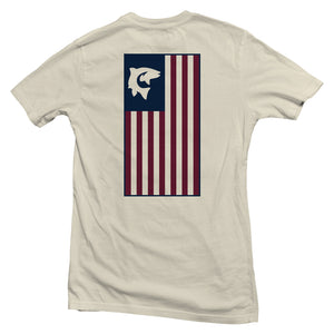 The back of a cream colored, Nuvo brand, short sleeve graphic t-shirt featuring a large, vertical American flag with a fish and hook in top left corner