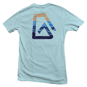 The back of a light blue , Nuvo brand, short sleeve graphic t-shirt featuring ombre mountain pattern in Nuvo logo