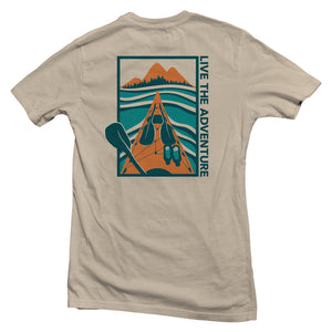 The back of a cream-colored, Nuvo brand, short sleeve graphic t-shirt featuring kayak on lake with mountains in the distance