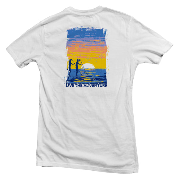 The back of a white, Nuvo brand, short sleeve graphic t-shirt featuring two people paddle boarding in the ocean at sunset