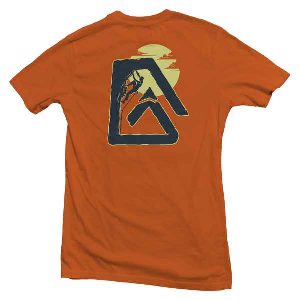 The back of a burnt orange, Nuvo brand, short sleeve graphic t-shirt featuring rock climber inside Nuvo logo
