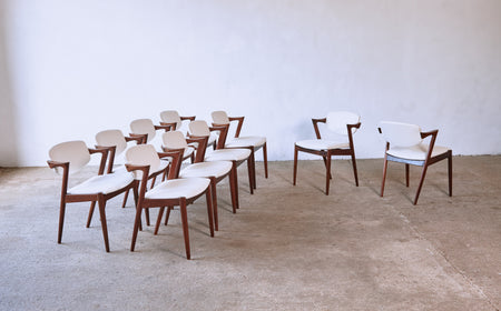 /products/set-of-ten-model-42-rosewood-dining-chairs-by-kai-kristiansen-denmark-1960s