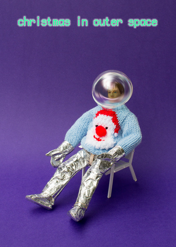Christmas in Outer Space - astronaut in woolly jumper relaxing