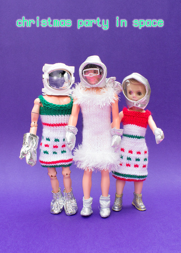 Christmas party in space - astronauts wearing woolly dresses