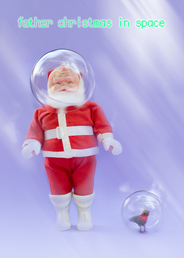 Father Christmas in space - with a robin in a space globe