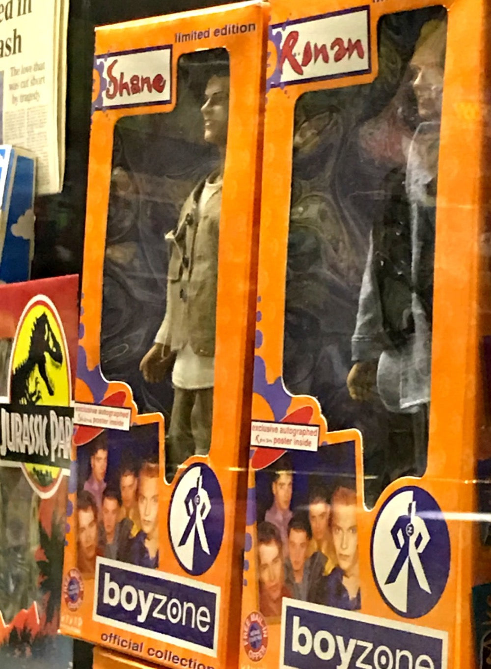 Boyzone dolls in orange packaging
