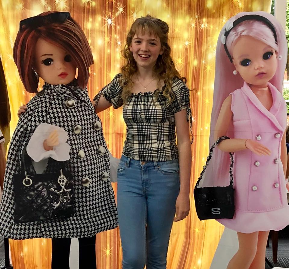 Cheryl Sewell with giant Sindy doll cut out figures.