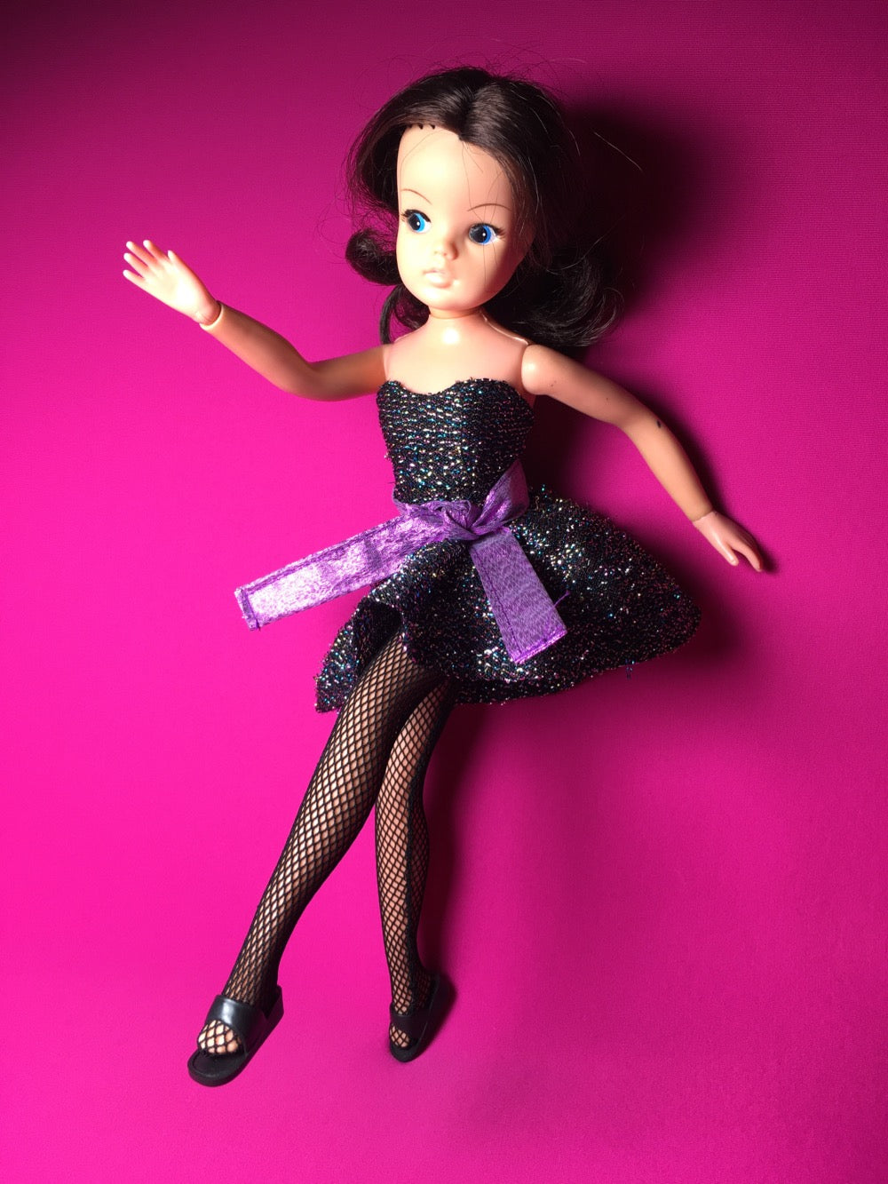 Sindy dancing in Party Piece black sparkly dress