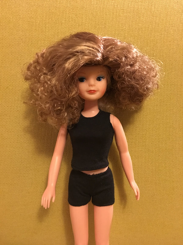 Smirky Sindy wearing curly blonde wig.