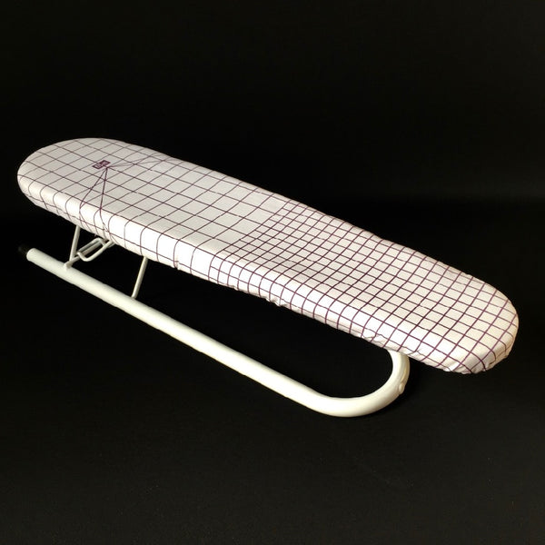 Sleeve ironing board with grid marks to help with dress making.