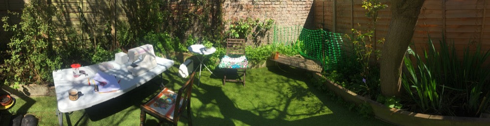 Sewing in the garden with my machine and a fold out table.