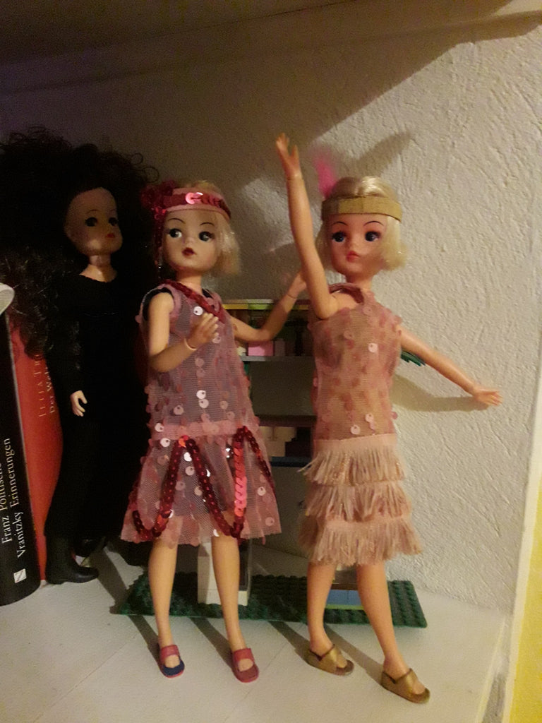 Two Sindy dolls with bob hair cuts and handmade flapper dresses