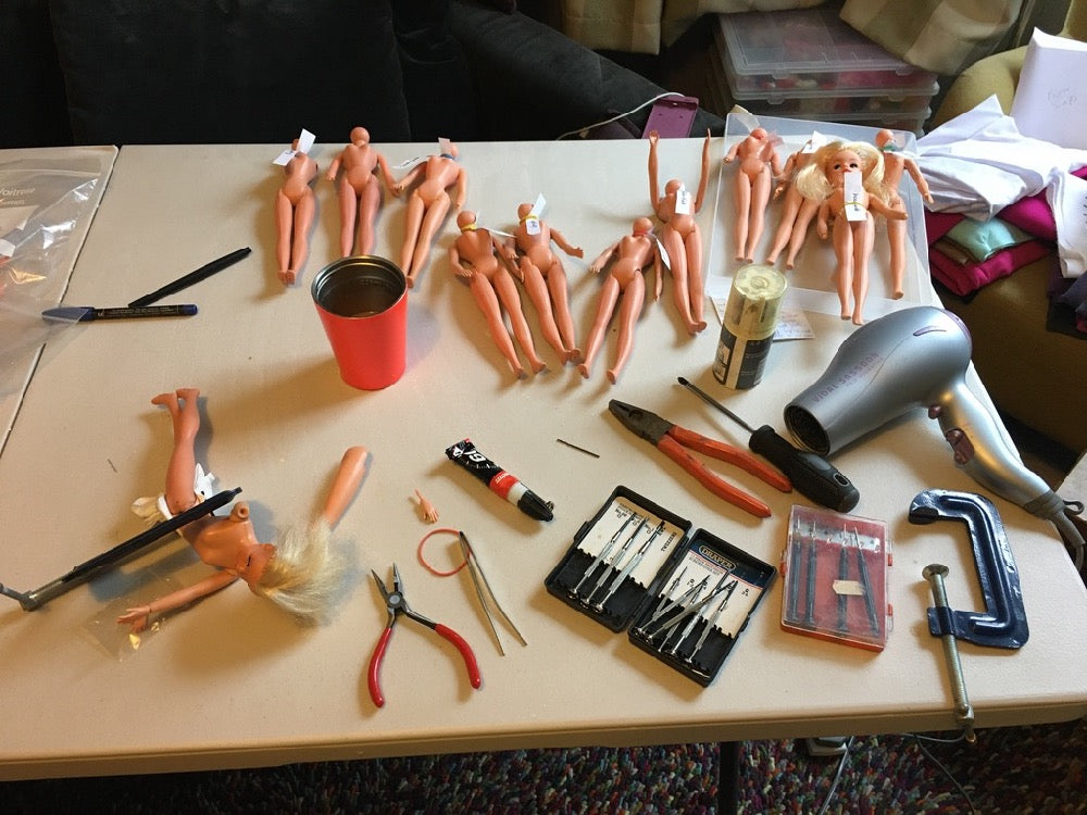 My desk with Sindy bodies, tools and spare limbs