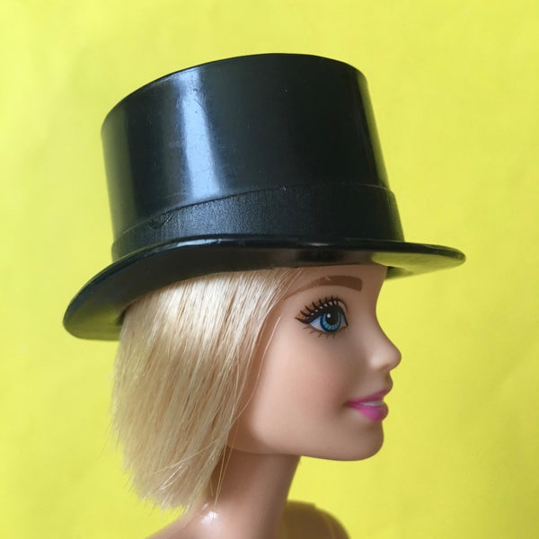 Barbie wearing black top hat