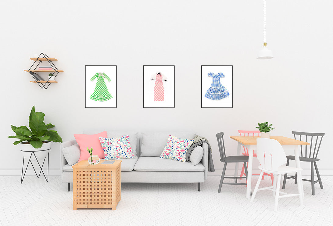 Prints of three gingham dresses in a living room