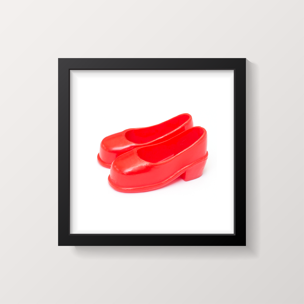 Framed square picture of Sindy red court shoes