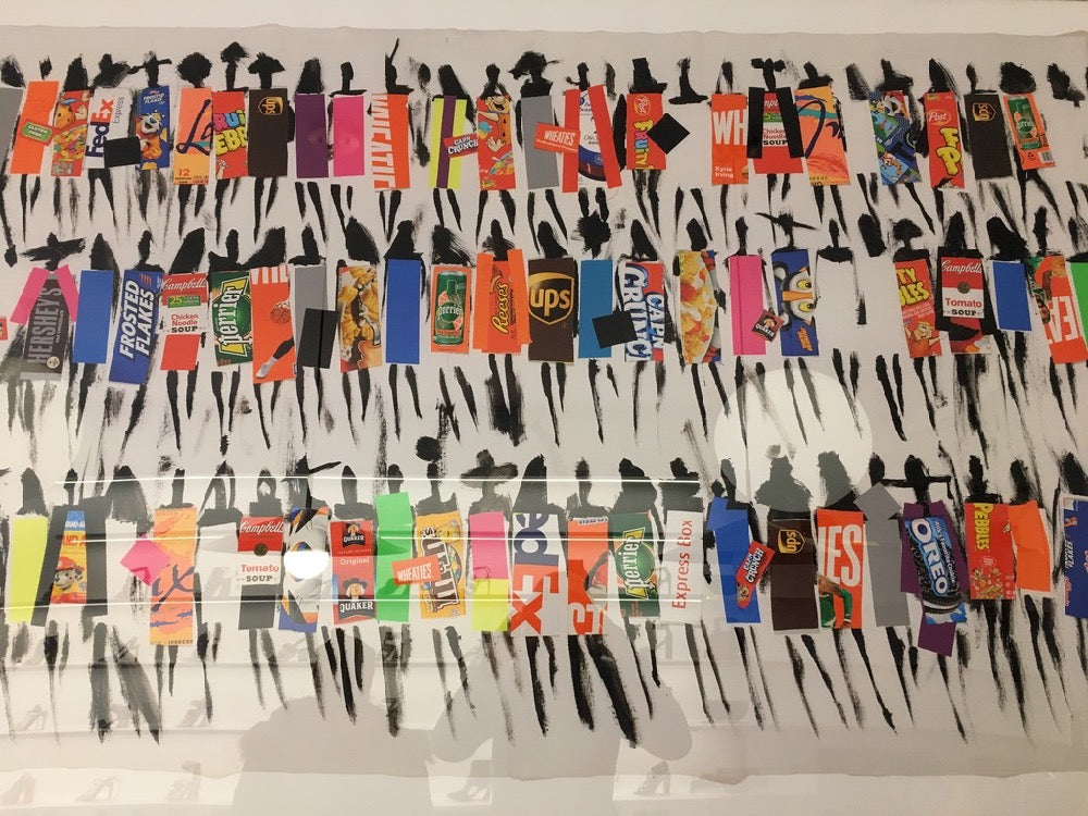 Painting collage with brand logos in Kat Maconie shop