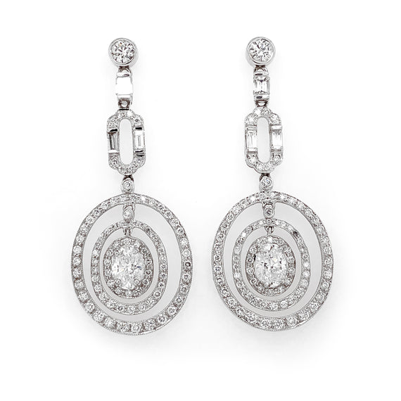 GIA Certified Oval Cut Diamonds 2.02 Carat Dangling Platinum Earrings