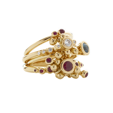 Diamonds, rubies and topaz adorn this 18ct gold ring. Driven by innovative design Yen Jewellery demonstrates here the ingenuity of her work. These gold rings are perfect for stacking in varying combinations. These rings feel fresh, colourful and spring-like.