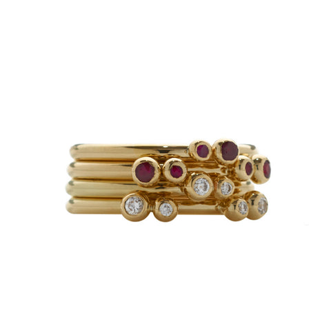 A multiplicity rubies and diamonds, stacked to perfection on 18ct gold bands. The clever design allows for varying combinations of stacking.