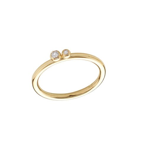 Two diamonds set on an 18ct gold slim shank. Versatile and perfect for stacking. Handmade by Yen Jewellery.