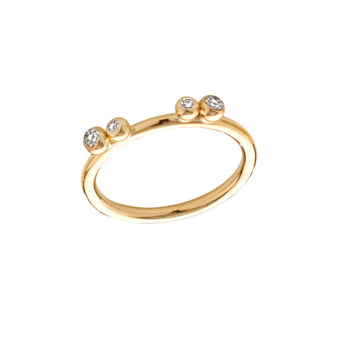 Four diamonds set upon a slim 18ct gold band. The diamonds are encased in a round gold setting, imbuing a botanical and natural feel. Handmade by Yen Jewellery from concept to creation.