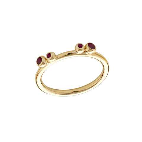 Four rubies set in groups of two on a slim 18ct gold shank. A considered design that makes them perfect for stacking.