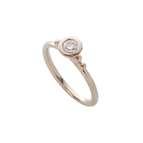 A dazzling diamond sits in the centre of each 18ct white gold ring. The perfect alternative engagement ring. Unique and handmade by Yen Jewellery, London