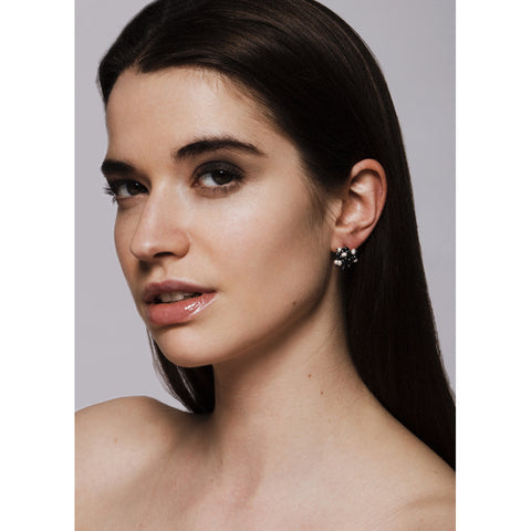 Model wears oxidised silver and pearl cluster stud earrings. Made by Yen Jewellery