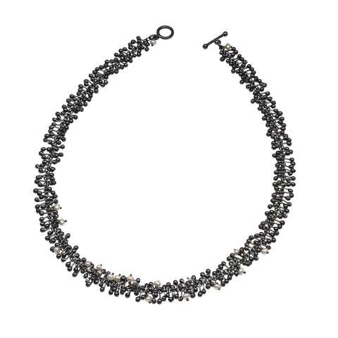 Freshwater pearls and handmade oxidised silver beads create this statement necklace. Perfect for livening up work attire or complementing evening wear.