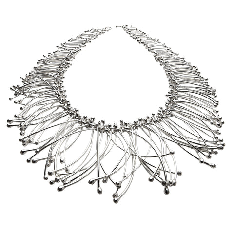 Long silver strands connected to form a bold silver choker necklace. Designed and handmade by Yen Jewellery