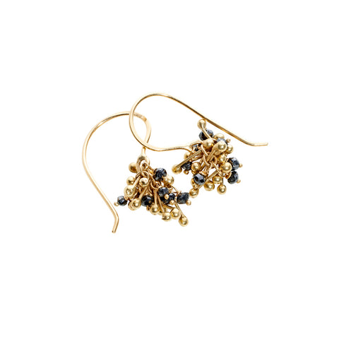 A cluster of 18ct gold and black diamonds. Cluster earring handmade by Yen Jewellery