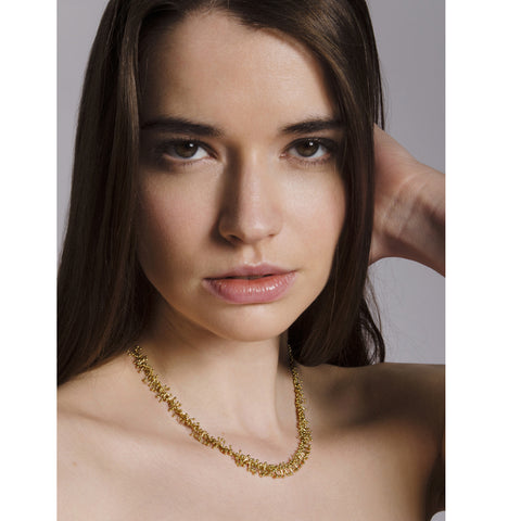 Model wears 18ct gold choker necklace. Handmade by Yen Jewellery