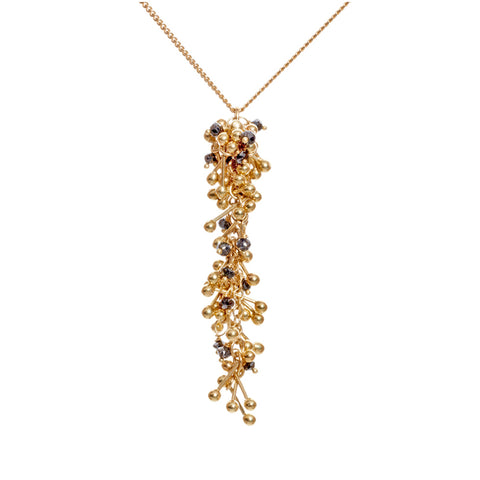 A long rich cluster of 18ct gold and black diamonds hang from an 18ct gold chain. Handmade by Yen Jewellery