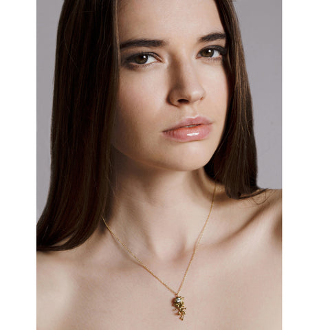 Model wears 18ct gold and white diamond necklace. Cluster hangs centrally from an 18ct gold chain