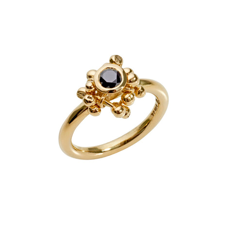 18ct gold and black diamond statement ring. A cluster of gold elements and a central diamond. Handmade by Yen Jewellery