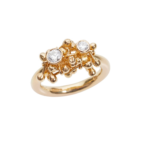18ct gold cluster and two white diamonds sit on the gold shank. A ring designed and handmade by Yen Jewellery